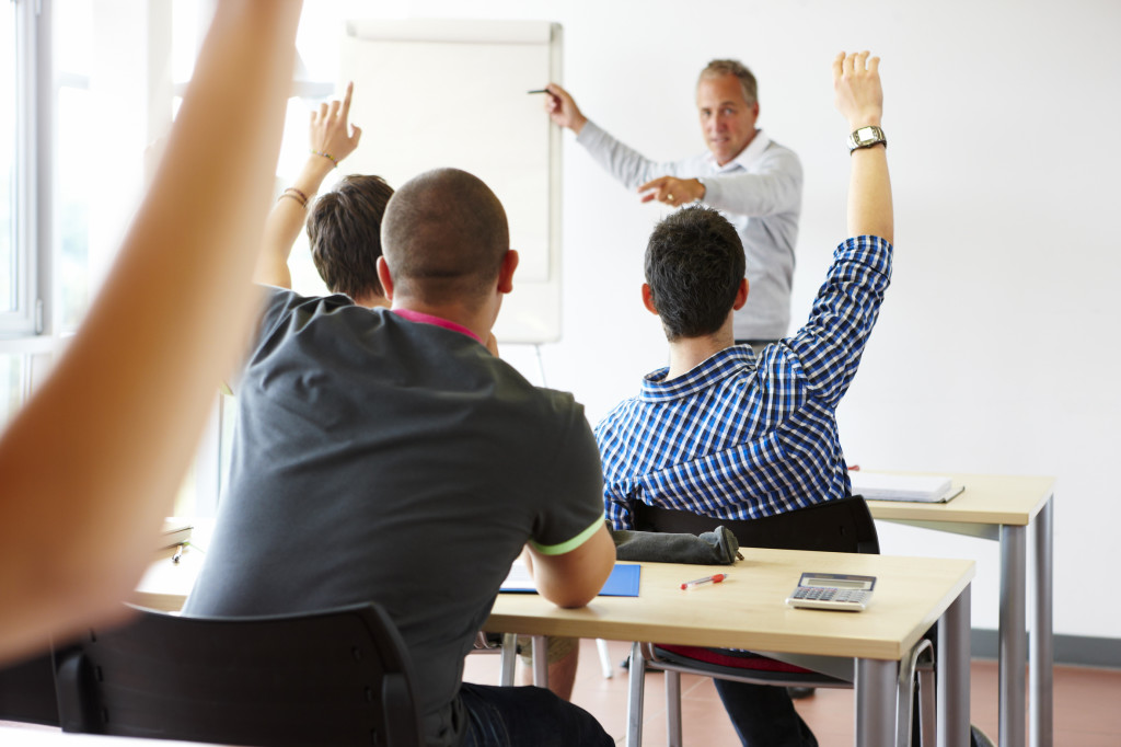 teacher in classroom with eager students