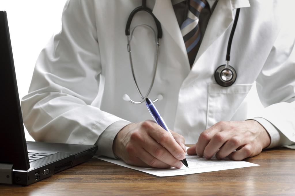 Writing a prescription or medical examination notes
