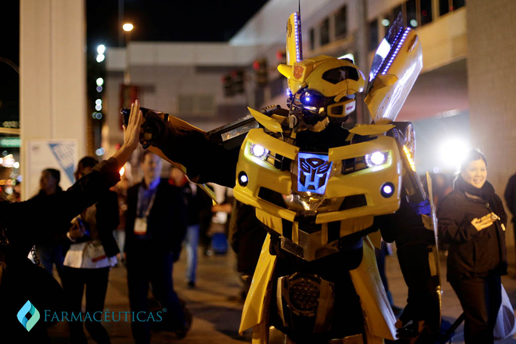 "A man dressed as the Bumblebee from the ""Transformers"" movie series gets a high-five from a show attendee outside the Las Vegas Convention Center on the first day of the International Consumer Electronics Show (CES) on Tuesday, Jan. 7, 2014, in Las Vegas. (AP Photo/Jae C. Hong)"